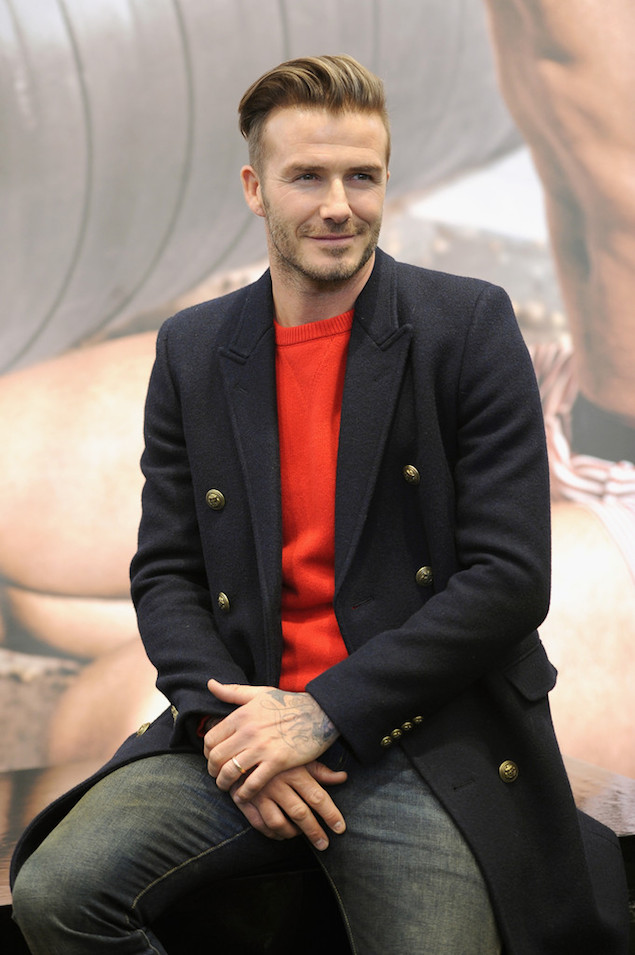 David-Beckham-wears-navy-Saint-Laurent-double-breasted-gold-buttoned-officer-coat-and-Alexander-McQueen-Red-Cashmere-Crew-Neck-Sweater-.jpg
